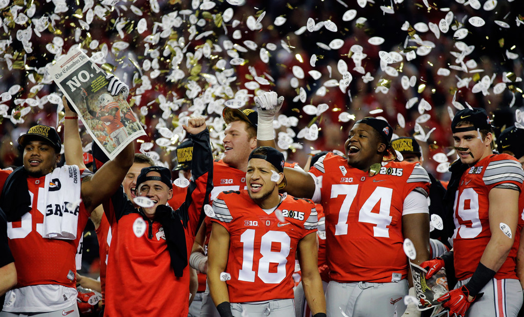 Ohio State players celebrate their NCAA football playoff championship against Oregon on Monday night in Arlington, Texas. Ohio State won, 42-20.