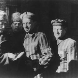 Three Auschwitz prisoners talk with Soviet soldiers after the Nazi concentration camp in Poland, was liberated by the Russians in January 1945. The Associated Press