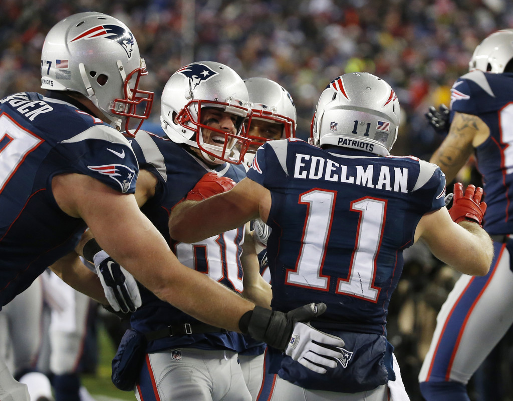 New England Patriots wide receiver Danny Amendola, center, celebrates his 51-yard touchdown pass from Julian Edelman against the Baltimore Ravens Saturday. The Associated Press
