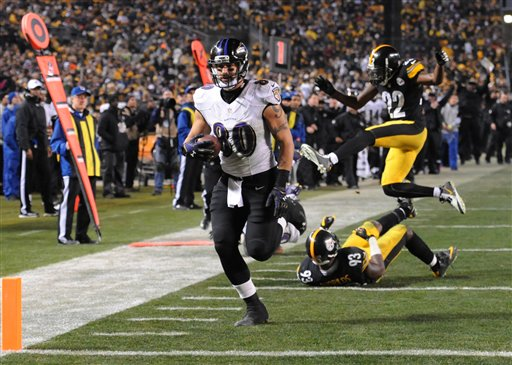Baltimore Ravens tight end Crockett Gillmore heads for the end zone and a touchdown in the fourth quarter of Saturday's wildcard playoff game against the Pittsburgh Steelers in Pittsburgh. The Associated Press