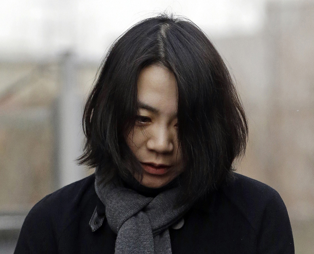 Cho Hyun-ah, who was head of cabin service at Korean Air and the oldest child of Korean Air Chairman Cho Yang-ho, is questioned by the media In this Dec. 12, 2014, photo.