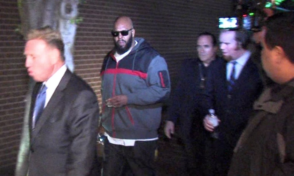"An image from video of Death Row Records founder Marion ""Suge"" Knight, right, walking into the Los Angeles County Sheriff's Department early Friday morning in connection with a hit-and-run incident that left one man dead and another injured. The Associated Press / OnSceneVideo"