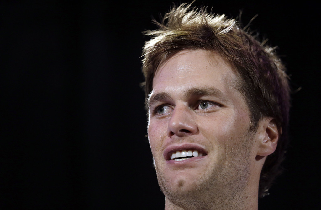 New England Patriots quarterback Tom Brady answers questions during a news conference Thursday in Chandler, Ariz. The Patriots play the Seattle Seahawks in Super Bowl XLIX Sunday. The Associated Press