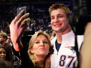 Rob Gronkowski poses for a selfie with television sportscaster Charissa Thompson during Super Bowl media day on Tuesday in Phoenix.