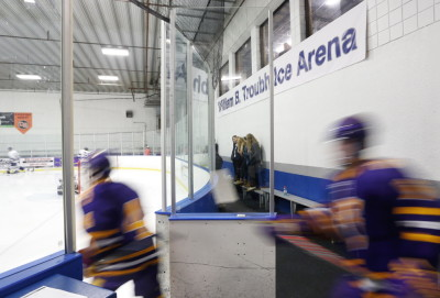 "Cheverus hockey players take the ice during their City Cup game at the William B. Troubh Ice Arena, newly renamed in honor of its chief supporter. ""Bill knew how important wintertime activities were for the kids,"" said Joe Gray, a former city official."