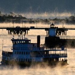 Passengers brave a subzero temperatures to ride on an outdoor deck of a ferry making its way through arctic sea smoke off Portland on Thursday. It may have been cold, but it didn't break any records.