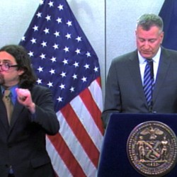In this video frame grab released by New York City Office of The Mayor, sign-language Interpreter Jonathan Lamberton translates during a Monday news conference by Mayor Bill de Blasio . The Associated Press