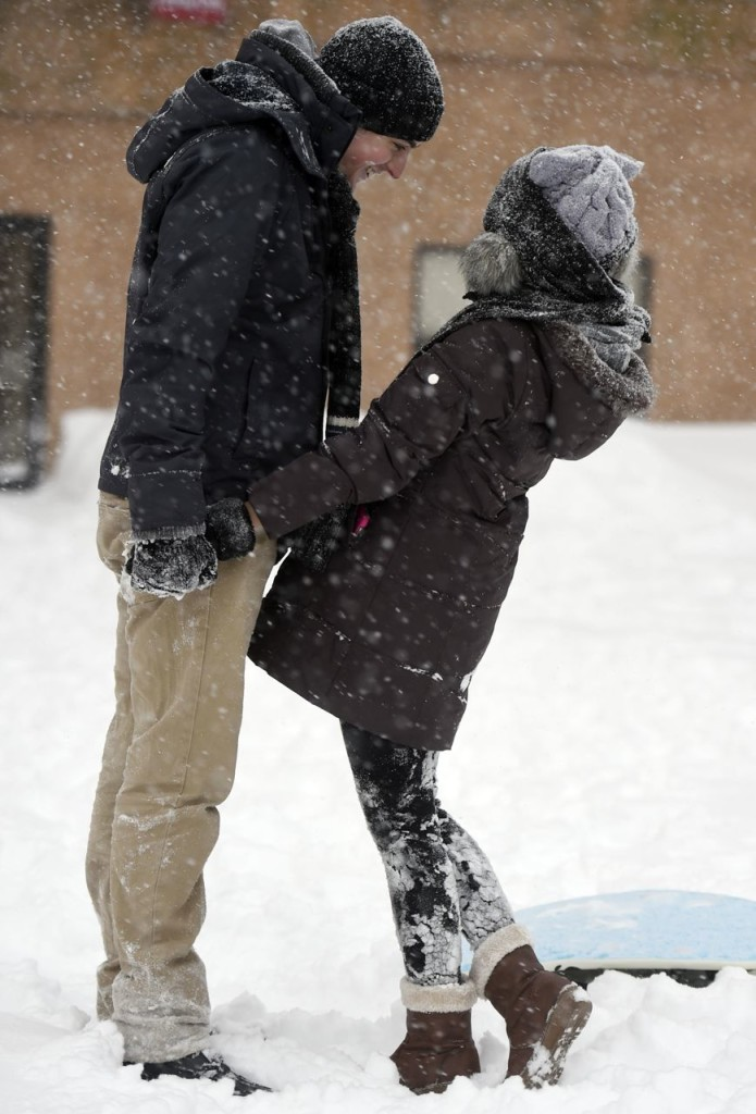 Pear Sutuntanjai, right, and Aaron Gionet play in the snow  in downtown Norwich, Conn., Tuesday. Sutuntanjai is from Thailand and this is her first-ever experience of snow. The Associated Press / The Day, Sean D. Elliot