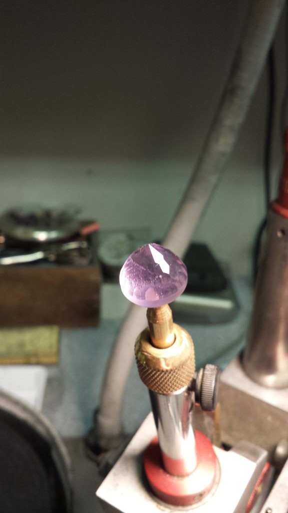 After pre-forming the gemstone undergoes the first steps in the polishing process. Photo courtesy of Creaser Jewelers