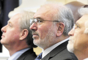 """John Fitzsimmons, center, who was president of the Maine Community College System for 25 years, resigned this month after a warning from Gov. Paul LePage that the system would """"feel the wrath"""" if he didn't."""