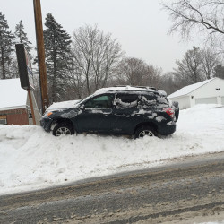 Slick conditions Friday morning have caused a number of cars to slide off the road, including this one on Washington Avenue in Portland.