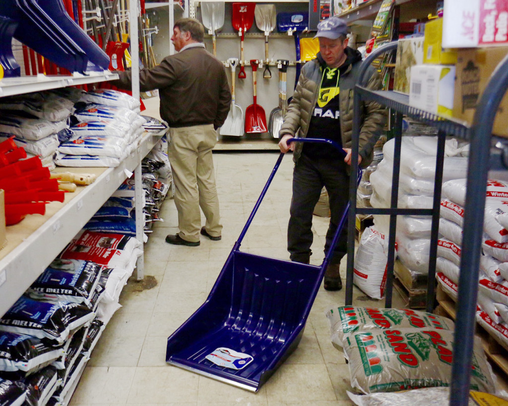 People shop for shovels Monday at Maine Hardware on St. John Street in Portland. A major snowstorm was expected to hit the area beginning late Monday evening.