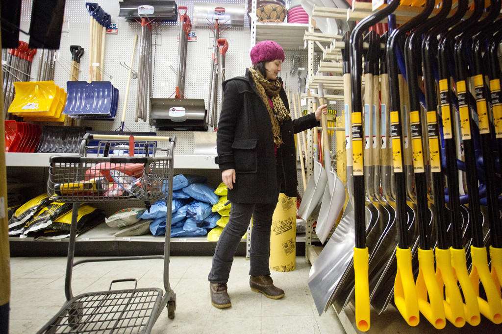 Emily Van Cannon picks up a shovel to purchase at Maine Hardware on St. John Street in Portland Monday. Van Cannon, of South Portland, was shopping for group homes in the area.