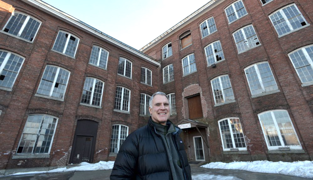 Paul Boghossian, owner and developer of the Hathaway Creative Center, stands in front of the old Marden's and CMP building at the Hathaway complex on Wednesday. Michael G. Seamans / Morning Sentinel Staff Photographer