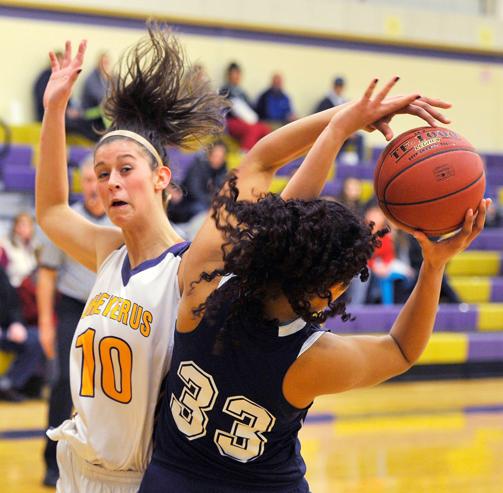 Cheverus' Jillian Libby battles for a rebound with Portland's Gabrielle Wagabaza during the Bulldogs' 67-63 girls' basketball playoff win.