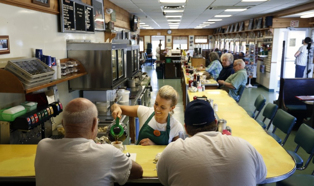 A waitress pours coffee for customers at Moody's Diner in Waldoboro in this May 2013 photo. Gabe Souza/Staff Photographer