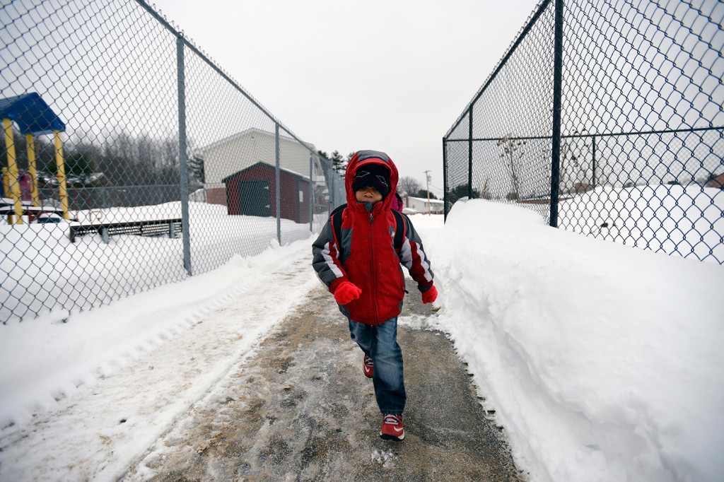 Hudeyfa is bundled up against the cold as he runs to the bus stop.