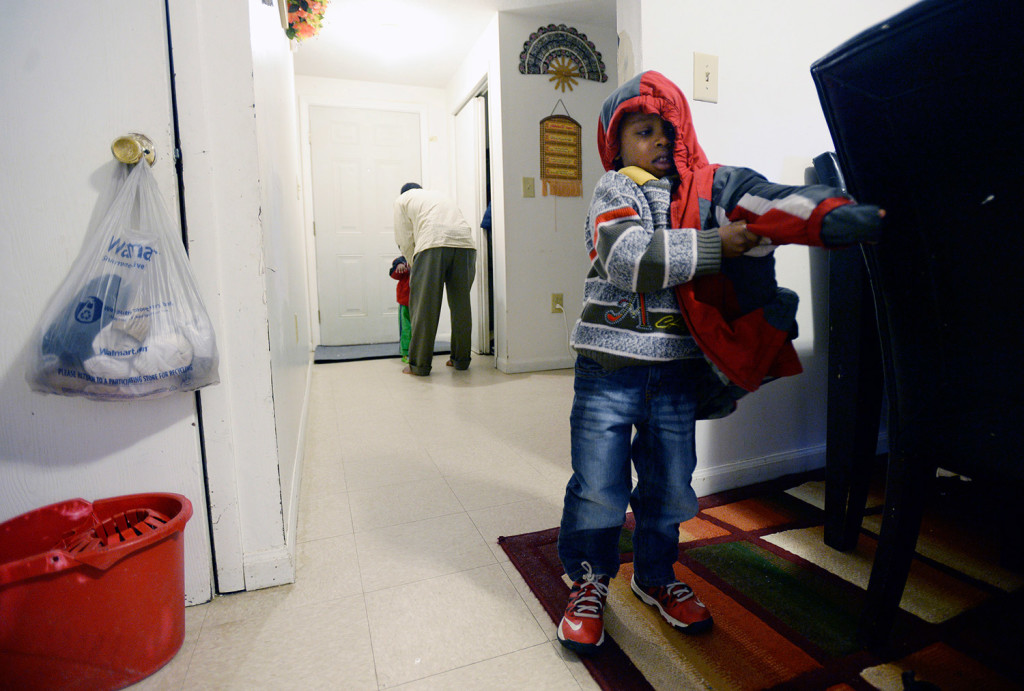 Hudeyfa puts on his jacket before heading off to school.