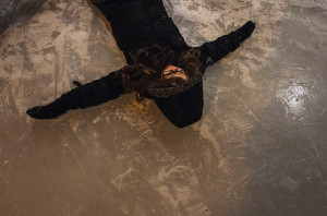 Cillian Fox lies on the ice before attempting to ice-skate at the Bruce Fox Memorial Ice Rink.