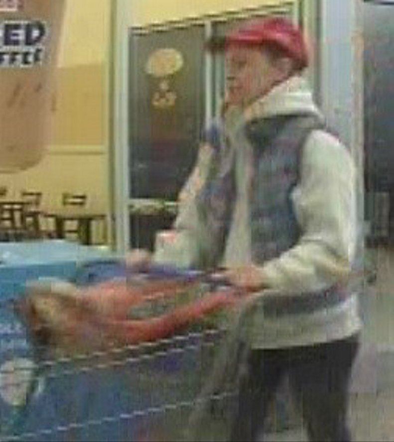 This photo taken from a security camera shows a woman suspected of stealing a television set from the Walmart store in Farmington.
