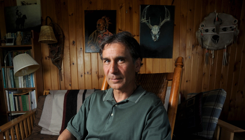 Barry Dana, of Solon, sits for a portrait in his home in May.