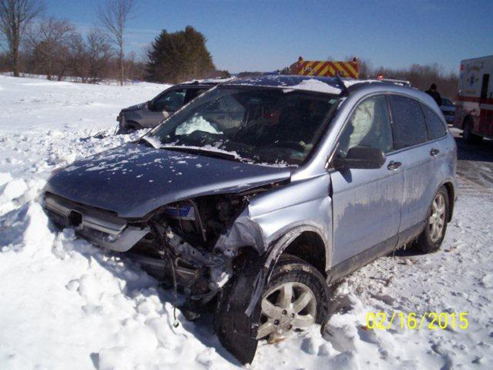 Two people from this Honda CRV were treated at Central Maine Medical Center in Lewiston following a four-vehicle crash on the Maine Turnpike Monday morning. Photo contributed by Trooper Bill Baker