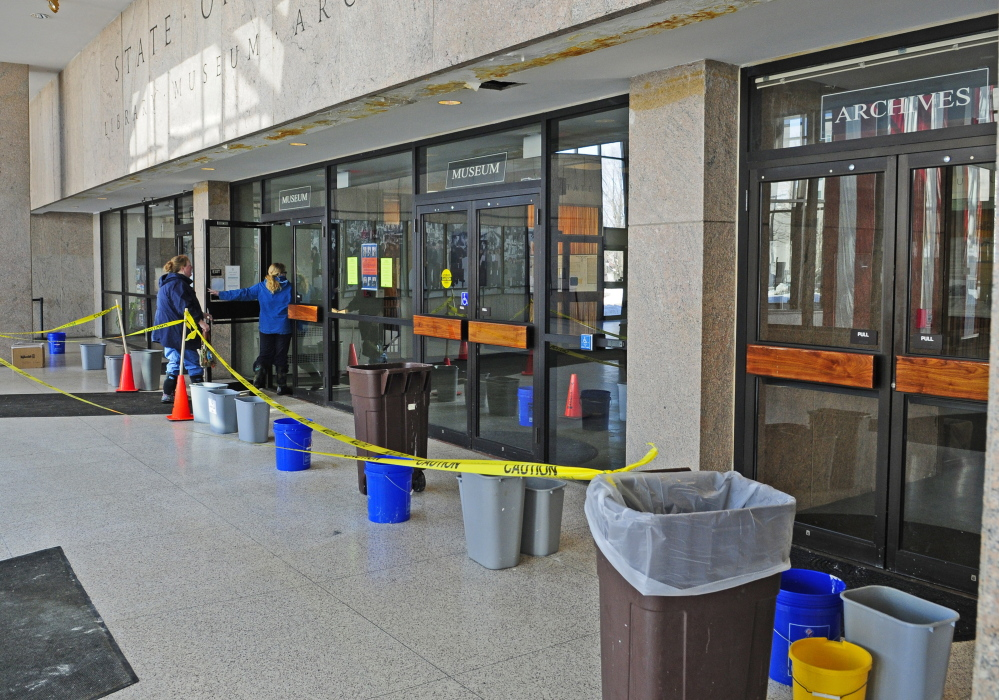 Visitors to the state library, museum and archives will see buckets and trash cans strategically placed to catch drips from the leaking ceiling in the Maine State Cultural Building lobby in Augusta.