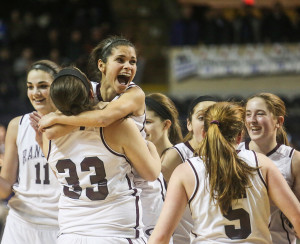 FEB. 27 FINALS: Greely guard Hannah Stewart wraps her arms around teammate Samantha Kane after their victory Friday night against Presque Isle in the Class B girls' state championship game.