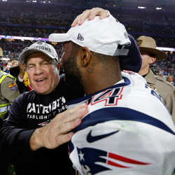 New England Patriots coach Bill Belichick celebrates with cornerback Darrelle Revis after Sunday's Super Bowl victory against the Seattle Seahawks. The team must decide what to do about Revis' contract, which calls for him to be paid $20 million next season.