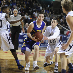 Portland  vs. Falmouth in the regional class A final basketball game. Falmouth's Colin Coyne drives into the lane past Portland's Liam Densmore looking for room to shoot. John Ewing/Staff Photographer