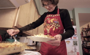 Bonnie McKenney serves her homemade tuna noodle casserole in her Boothbay Harbor kitchen.