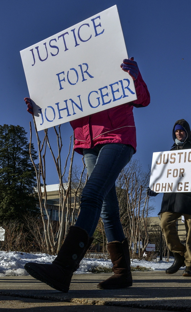 "A group called ""Justice for John Geer"" pickets outside the Fairfax County police department on Jan. 8. A federal investigation of the police department's shooting of Geer is underway."