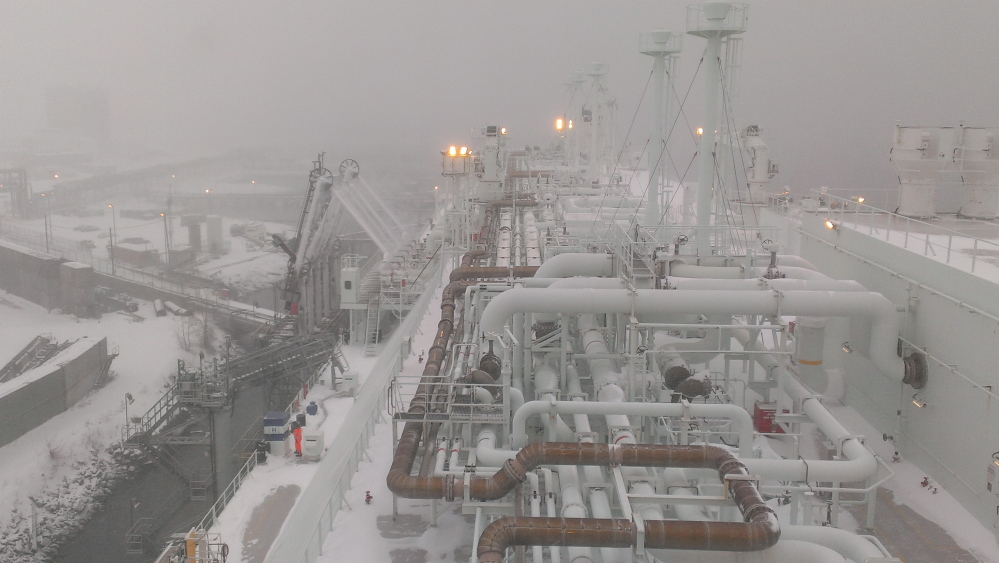 Seen from aboard ship, the LNG carrier GDF Suez Neptune is docked during last Tuesday's blizzard at the GDF Suez marine terminal in Everett, Mass. The liquefied natural gas it unloaded last week is expected to help shore up tight supplies in New England during cold weather in the next few weeks.