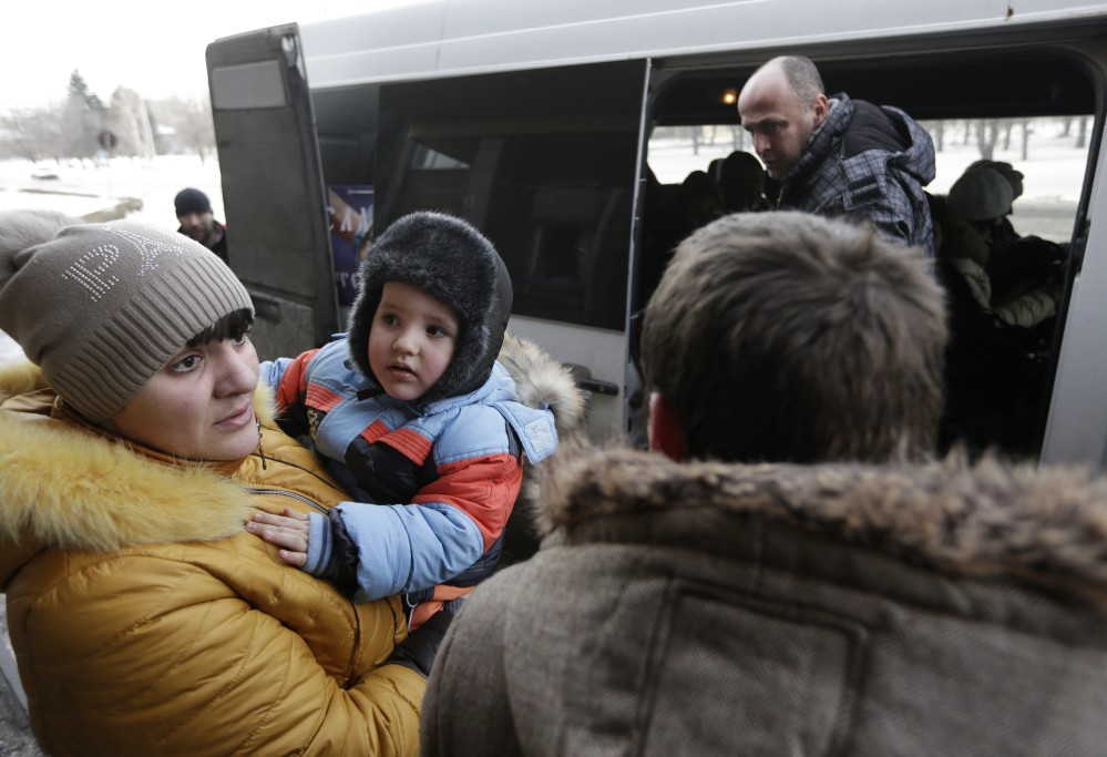 People board a bus to leave Debaltseve, Ukraine, on Saturday. They had gone without power, water and gas for at least 10 days in their embattled town.