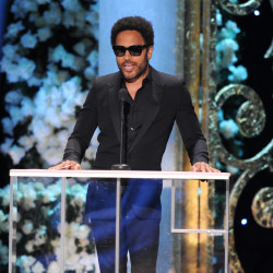 Lenny Kravitz presents the award for outstanding ensemble in a comedy series on stage at the 21st annual Screen Actors Guild Awards at the Shrine Auditorium on Jan. 25 in Los Angeles.  The Associated Press