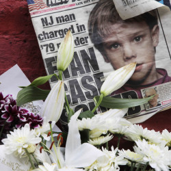 A newspaper from 2012 with a photograph of Etan Patz is among items placed at a makeshift memorial in the SoHo neighborhood of New York where Patz lived before his disappearance on May 25, 1979.
