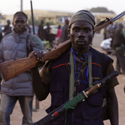Vigilantes and local hunters gather before they go on patrol in Yola, Nigeria. Reports say Nigerian troops are inadequately equipped.