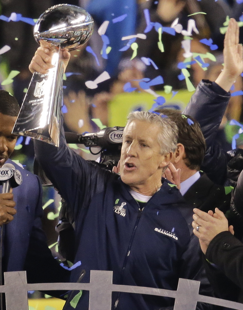 Seattle Seahawks Coach Pete Carroll took the time to hold up the Lombardi Trophy after his team won the Super Bowl last season, then wasted no time beginning the planning process for a repeat. Sunday night, he and his team look to do it again.