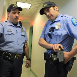 "A St. Louis patrolman, right, gets training on handling a Taser. Police need to be trained to think differently in potentially violent situations, say officials looking to reduce deadly force incidents. ""Tactical retreat"" is a method advocated by some."