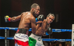 Russell Lamour, left, takes a left from Thomas Falowo during their fight for the New England middleweight title Friday night at Foxwoods Resort Casino in Mashantucket, Connecticut. Lamour lost the fight by unanimous decision, 78-74, 77-75, 77-75.