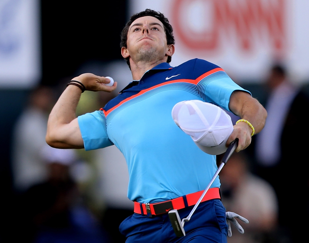 Rory McIlroy throws his ball to the crowd after he wins the Dubai Desert Classic golf tournament in United Arab Emirates on Sunday.
