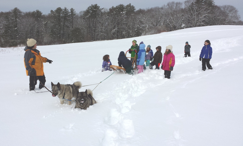 Dog sledding and other outdoor activities for children will be part of a school vacation day camp offered by the Damariscotta River Association. Registration is due by Feb. 9.