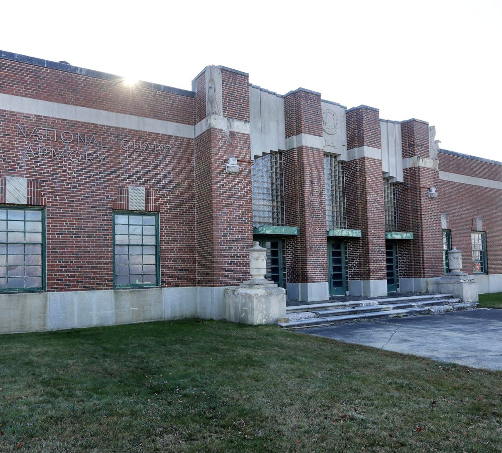 The former National Guard armory at the foot of the Casco Bay Bridge would be redeveloped into a gas station, convenience store, cafe, professional office space, community meeting space and a tourist information bureau. 2014 Press Herald file photo/Derek Davis