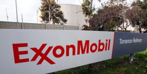Exxon Mobil on Monday posted a 21 percent decline in profit and revenue for the fourth quarter because of lower oil prices.