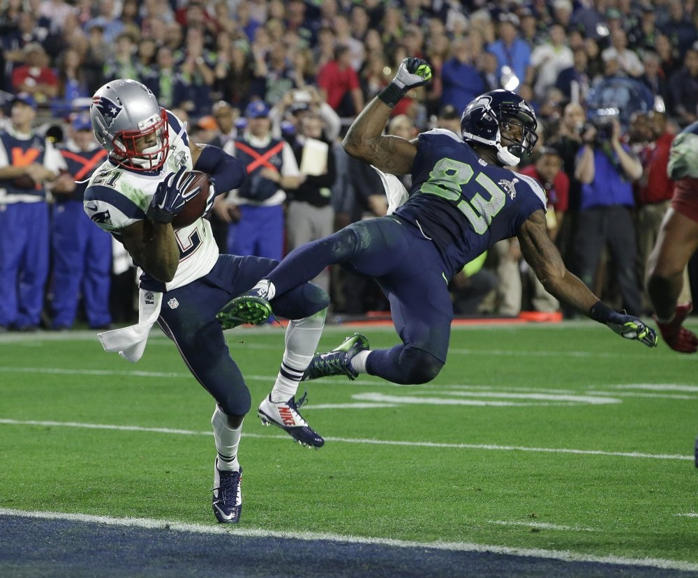 New England Patriots strong safety Malcolm Butler (21) intercepts a pass intended for Seattle Seahawks wide receiver Ricardo Lockette (83) during the second half of NFL Super Bowl XLIX football game Sunday, in Glendale, Ariz.