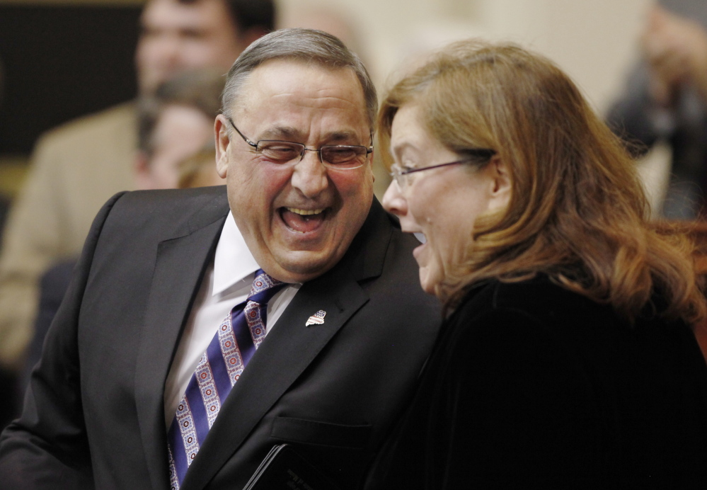Gov. Paul LePage shares a laugh with Maine Chief Justice Leigh Saufley following his State of the State address (The Associated Press/Joel Page)