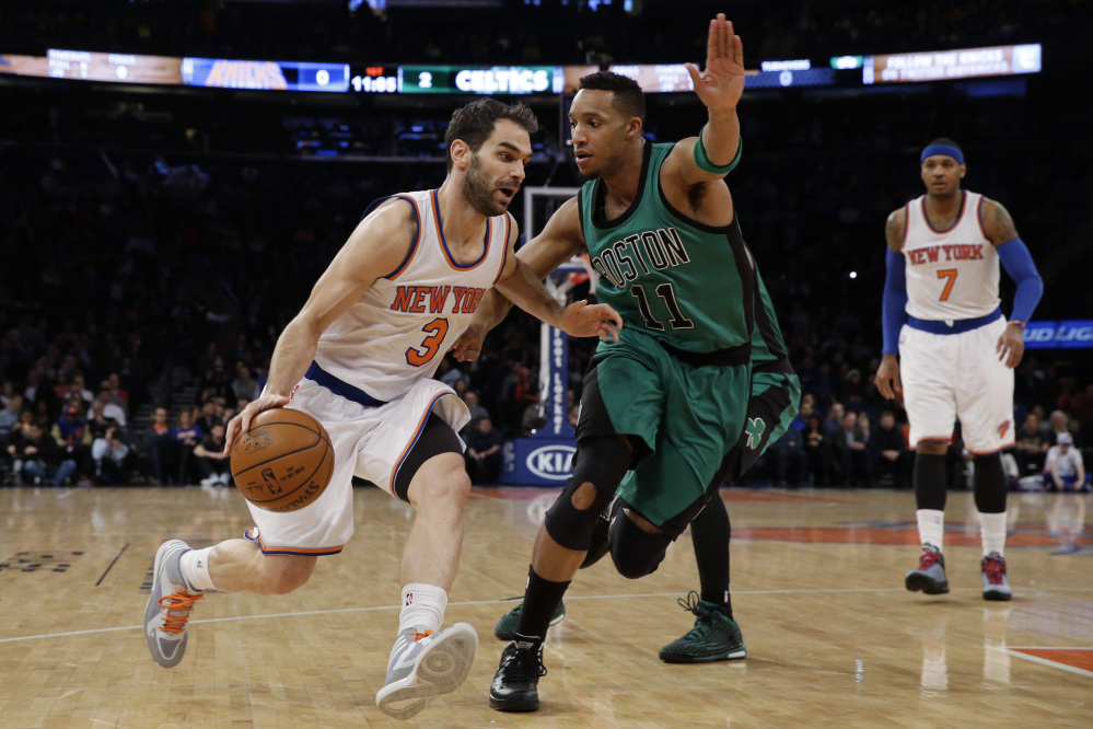 New York Knicks guard Jose Calderon drives toward the basket past Celtics guard Evan Turner during Tuesday night's game at Madison Square Garden. The Celtics won, 108-97, to end a three-game losing streak.