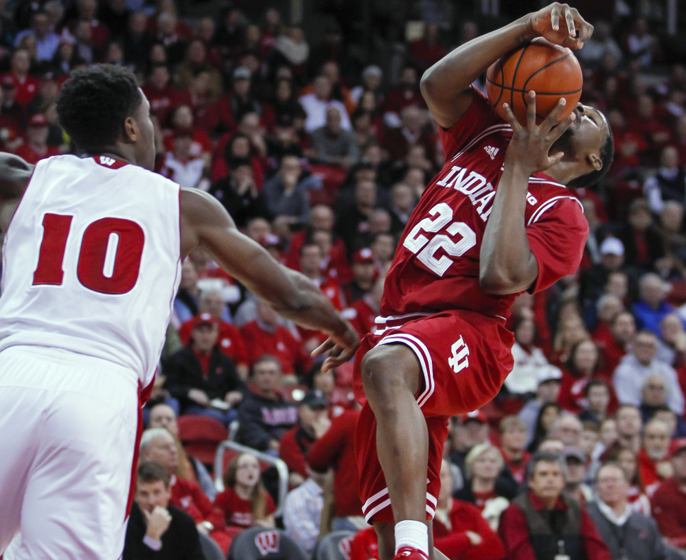 Indiana's Stanford Robinson, right, tries to get a shot off against Wisconsin's Nigel Hayes during the first half on Tuesday night in Madison, Wis. The host Badgers won 92-78.