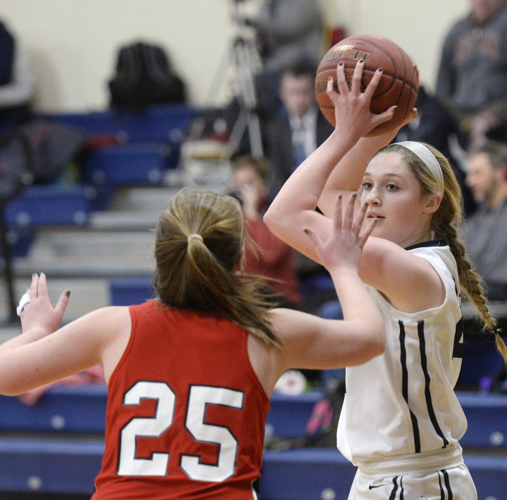 Alison Clark of Yarmouth looks for an open teammate Tuesday night while defended by Skye Conley of Gray-New Gloucester during Gray-New Gloucester's 43-27 victory at Yarmouth High.
