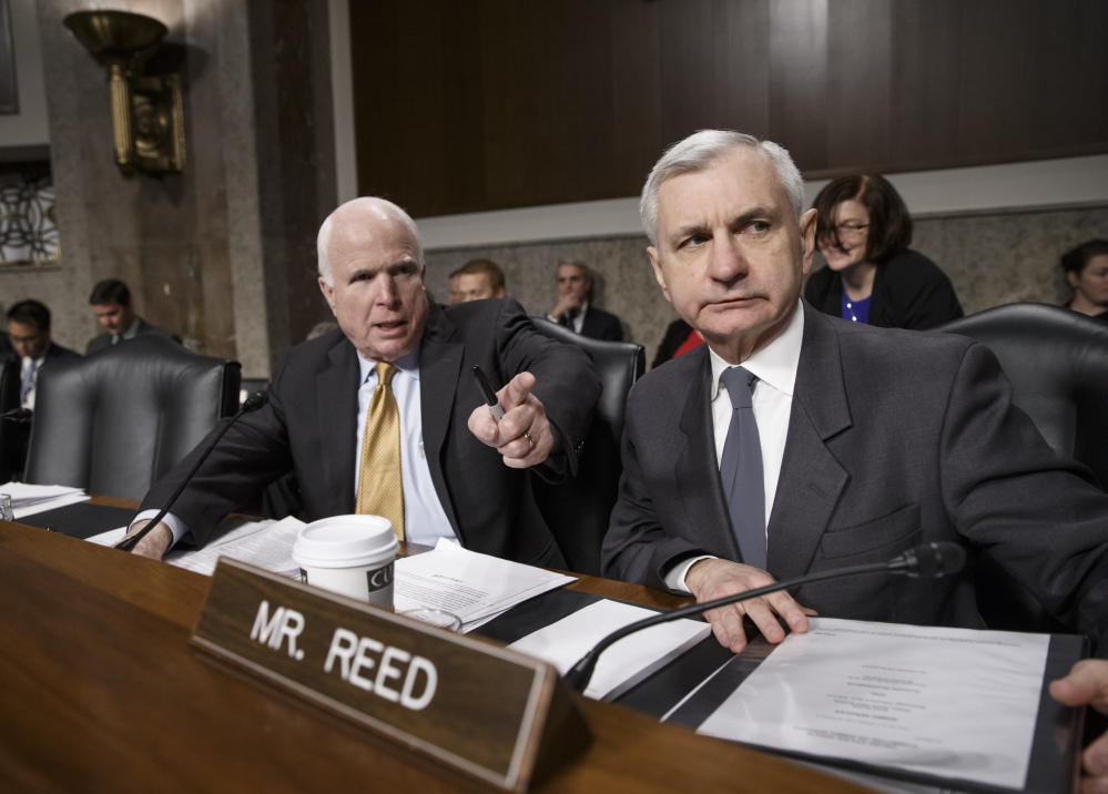 Senate Armed Services Committee Chairman Sen. John McCain, R-Ariz., left, and Sen. Jack Reed, D-R.I., lead the confirmation hearing for Ashton Carter on Wednesday.
